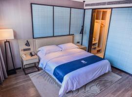 Echarm Hotel (Quanzhou Huaqiao University Strait Sports Center Branch), Quanzhou (Hui'an yakınında)