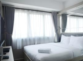 Cozy 1BR The Oasis Cikarang Apartment By Travelio