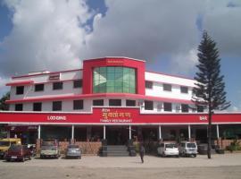 Hotel Muktangan, Khed (рядом с городом Nasrāpur)