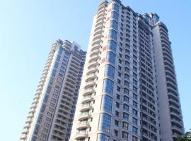 Qingdao Fuying Gailo Home International Aparthotel, Huangdao (Xin'an yakınında)