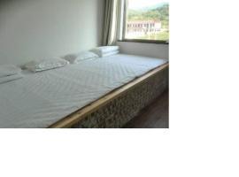 Mumaren Hotel, Wenshui (Zhongzhuang yakınında)