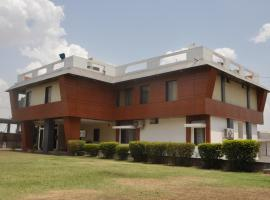 The best available hotels & places to stay near Mhow, India