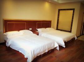 Xinhewan Business Hotel, Xiongzhou (Longnan yakınında)