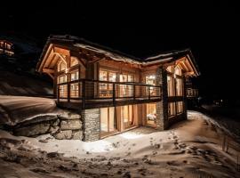 Swiss Alps Village Sarl