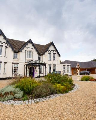 The Carlton Manor Hotel