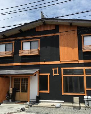 橙色小屋旅館