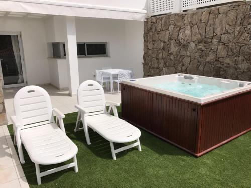 Reservar este hotel con jacuzzi · Description for a11y