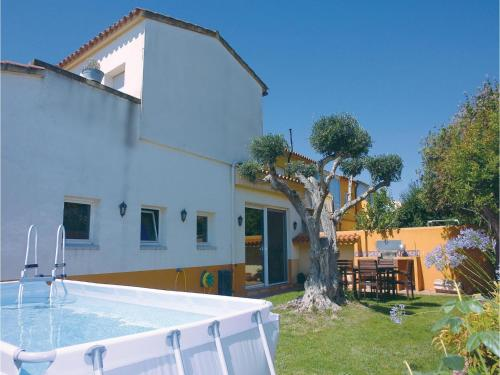 Description for a11y. Four-Bedroom Holiday Home in Sant Pere Pescador