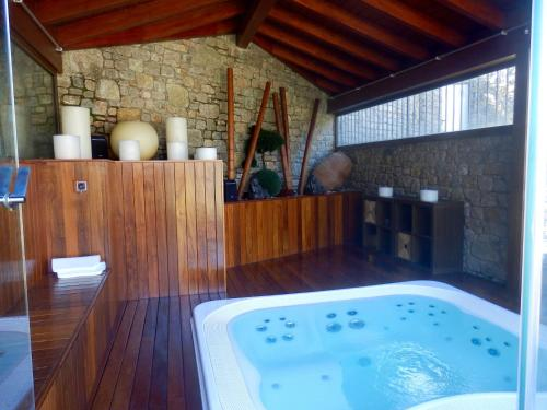 Reservar este hotel con jacuzzi · Description for a11y