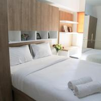 Comfortable 2 BR The Springlake Summarecon Apartment By Travelio