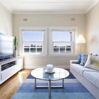 Spacious art deco apartment with beach views
