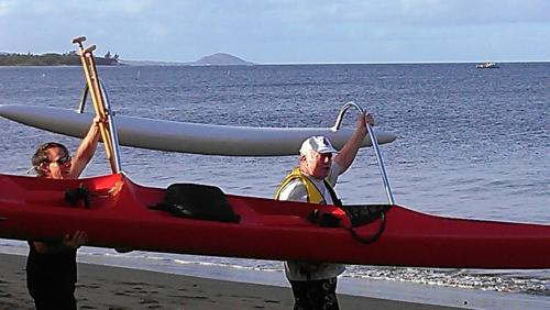 Ron going out paddling in front of Kihe Kai.